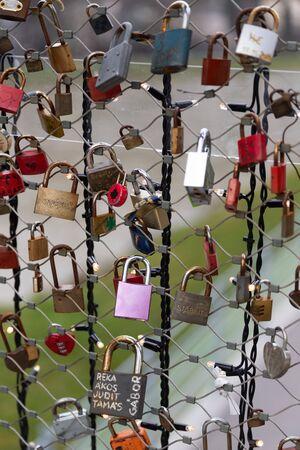 Love locks (padlocks) in a bridge over Salzach river in Salzburg, Austria