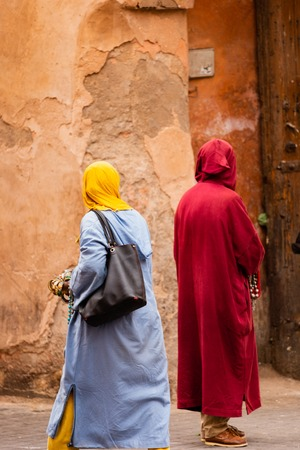 Peddlers trying to sell their products in the medina of Marrakesh, Morocco Stock Photo