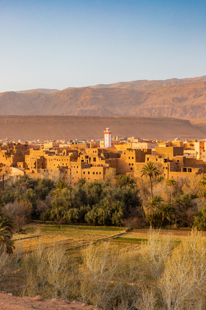 Town next to an oasis with fields and plantation in Tinghir, Morocco