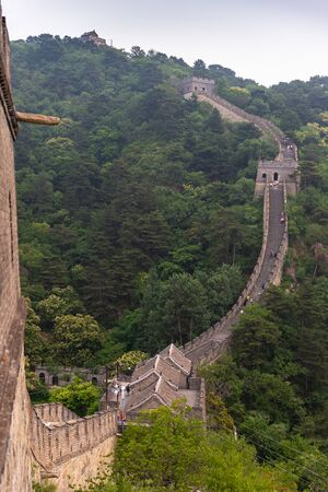 Great Wall and surrounding mountains on a misty, summer day