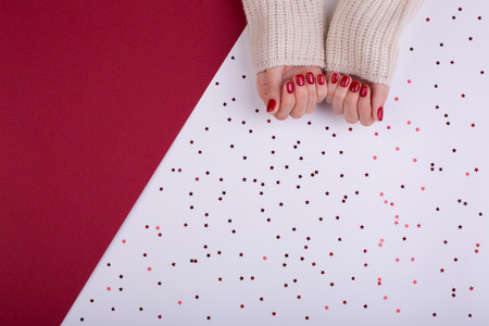 Red festive female manicure. Flat lay style.
