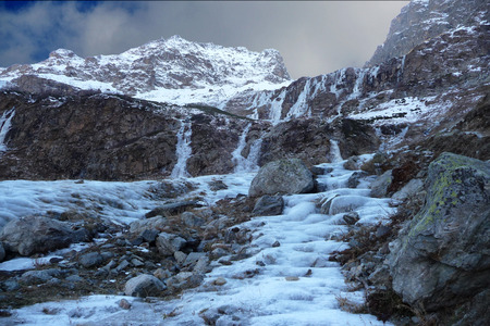evoke: Caucasus mountains, frozen waterfalls and rivers evoke strong feelings and emotions , beautiful landscape