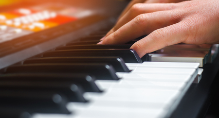 Close-up of a music performer's hand playing the piano, man's hand, classical music, keyboard, synthesizer, pianist