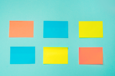 sticky stickers for notes on a blue background. time management, creative new idea. bad memory. reminder, place for text