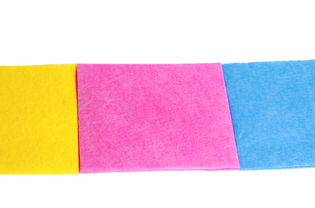 Multicolored rags for cleaning on a white background. cleanliness housekeeping concept, consumables