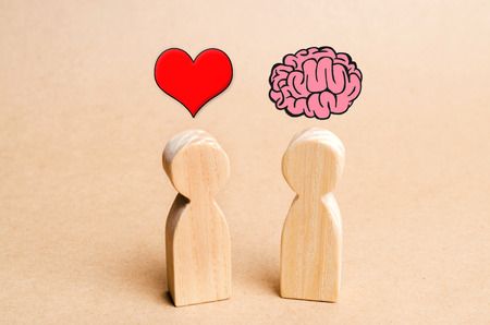 Heart vs Mind or brain. Concept of mind against love. Balance between irrational love and reason. Family psychology. Problems in relations Banco de Imagens