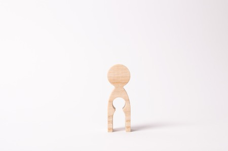 A wooden figure of a woman with a void inside in the shape of a child. The concept of the loss of child, abortion of pregnancy, miscarriage. Infertility in women. unhappy mother lost her child Reklamní fotografie