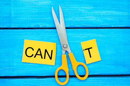 I can self motivation - cutting the letter t of the written word I can't so it says I can, goal achievement, potential, overcoming Foto de archivo