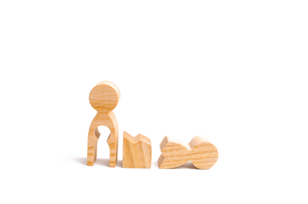 A broken wooden human figure and a mother with a void in the body. Strife in the family. One parent is broken, addicted to drugs or alcohol, gaming addiction. Difficulties in family life. Infertility. Stock Photo