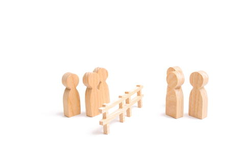 Termination and breakdown of relations, breaking ties. Contract break, conflict of interests. Negotiations of businessmen. A wooden fence divides the two groups discussing the case.