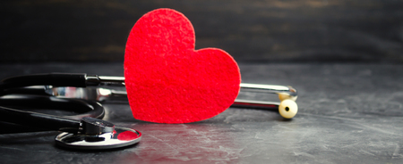 Red heart and stethoscope. The concept of medicine and health insurance, family, life. Ambulance. Cardiology Healthcare.