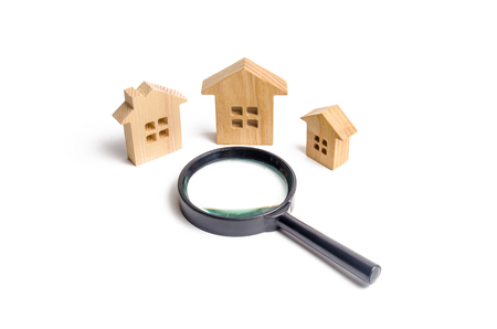 three wooden houses on a white background. The concept of urban planning, infrastructure projects. Buying and selling real estate, building new buildings, offices and homes. House search Banco de Imagens