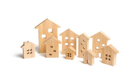 City of wooden houses on a white background. The concept of urban planning, infrastructure projects. Buying and selling real estate, building new buildings, offices and homes. Urban development. Фото со стока