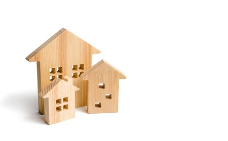 City of wooden houses on a white background. The concept of urban planning, infrastructure projects. Buying and selling real estate, building new buildings, offices and homes. Urban development. Banco de Imagens