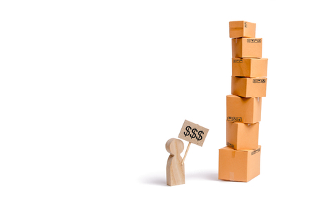 A tower of cardboard boxes and a figure of a man with a sign in his hands. A man sells his goods.. The concept of online sales, shopping and online shopping. Realization of goods and services