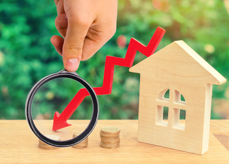 a decline in property prices. concept of depopulation. falling interest on the mortgage. reduction in demand for the purchase of housing. low prices for public utilities. arrow down. real estate