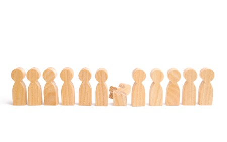 Weak player, worker for dismissal. A row of wooden people and a broken figure of a person among them. The concept of a weak link. Did not give up to expectations and did not fulfill the task.