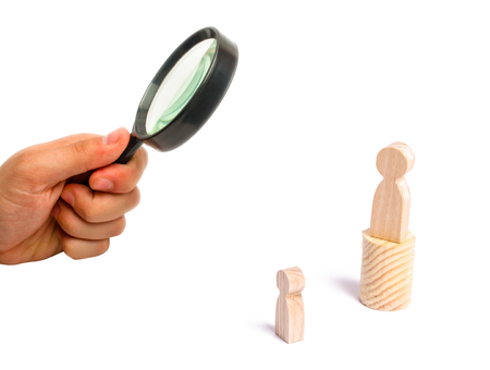 Magnifying glass is looking at the Magnifying glass is looking at the men stands on the podium and broadcasts his thoughts and ideas to listeners. The person gives orders, the leader, the boss.