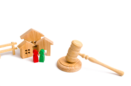 Wooden apartment house with people, keys and a judge hammer on a white background. The concept of laws and regulations for tenants and owners of a residential building. Condominiums.