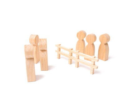 Negotiations of businessmen. A wooden fence divides the two groups discussing the case. Termination and breakdown of relations, breaking ties. Contract break, conflict of interests.
