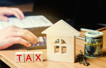 """Wooden house with the inscription """"Tax"""". Taxes on real estate, payment. Penalty, arrears. Register of taxpayers for property. Law-abiding, evasion of payment. Court law"""