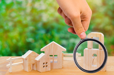 wooden houses with a lock. security in the city / region. Confiscation of property for debts. Safety and alarm system. Buying a new home. saving money for real estate. loan for a mortgage, collateral. Stock Photo
