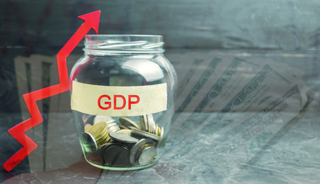 Glass jar with coins and the inscription  GDP  and up arrow. Business, economic, finance, salary, crisis. Economic growth concept. Market value. Gross Domestic Product increase Imagens