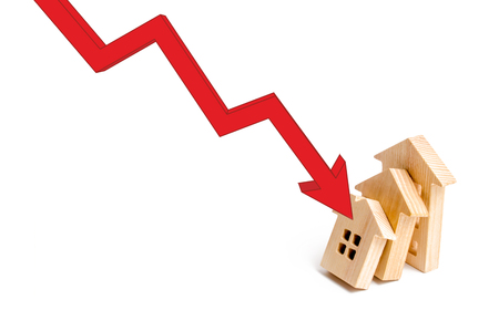 The red arrow triggers one another at home, a chain reaction of the fall. Colaps dominoes. Reclamation of the real estate market. falling prices and real estate demand, crisis and recession Stock fotó