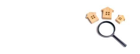 three wooden houses on a white background. Buying and selling real estate, building new buildings, offices and homes. House search. The concept of urban planning, infrastructure projects. banner