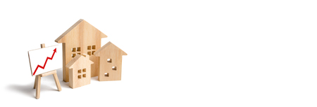 Wooden houses stand with red arrow up. Growing demand for housing and real estate. The growth of the city and its population. Investments. concept of rising prices for housing or rent. banner Stockfoto - 113940615