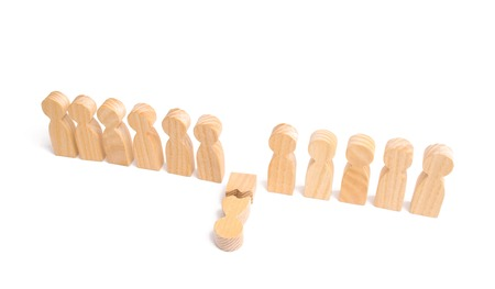 The concept of a weak link. A row of wooden people and a broken figure of a person among them. Did not give up to expectations. Weak player, worker for dismissal. mental health Stock Photo
