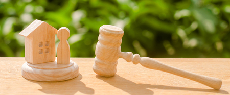 Protection of rights and confiscation of property judges hammer and the wooden and human figure. Concept of justice and litigation. decision of the fate of the defendant and property. Selective focus