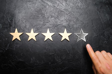 The man's hand in the suit points to the fifth missing star. Concept acquires the fifth star rating or status. Increase prestige and recognition. Loss of rank and status. Unsuccessful business. Critic