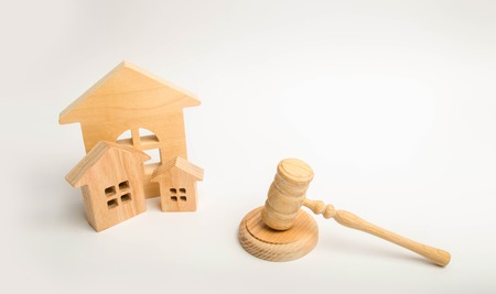 Judge's hammer and wooden houses. Local government, self-government in a city or township. Decentralization, reservation. Administrative District, Region. Public administration. laws Ratification