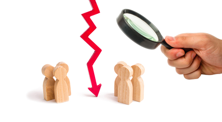 Magnifying glass is looking at the wooden red chart arrow down divides the two groups discussing the case. breaking ties. Contract break, conflict of interests. Negotiations of businessmen.