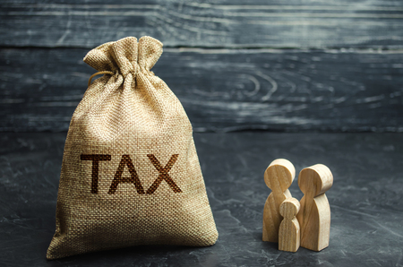 A bag with the word Tax and family. Taxes on real estate, payment. Penalty, arrears. Register of taxpayers for property. Law-abiding, evasion of payment. Court law. Luxury tax.