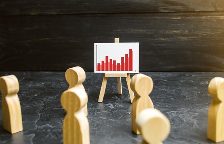 People gathered for a meeting and look at the speech of the leader. Profit and income analysis business webinar. Meeting or report for the past period. Analytics and strategy planning. Selective focus Stock Photo
