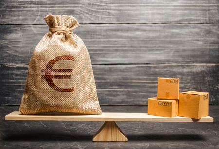 A bag of euro money and a bunch of boxes on the scales. Economic relations between subjects, the global economic model. Conceptual trade balance between countries and unions, trade and exchange goods