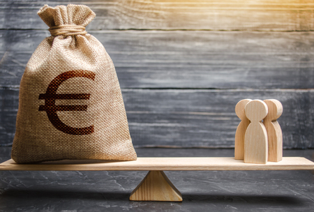 Money bag with a euro sign and people on the scales. evaluation of the cost of the work of specialists and workers. concept of attracting investment, business cooperation, crowdfunding and startup. Stok Fotoğraf
