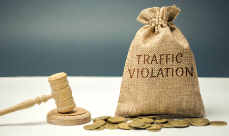 Money bag with the word Traffic violation and the judges hammer. Law. Court. Fine, legal fees. Traffic Tickets. Speeding. Failure to yield. Turning into the wrong lane. The layers services 写真素材