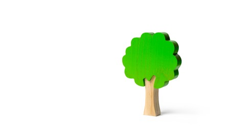 Toy wooden tree on an isolated background. Minimalism and the concept of environmental conservation. lungs of the planet. Family tree, a symbol of strength and wisdom. Illegal deforestation.