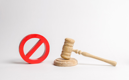 Judge's gavel and NO symbol. The concept of prohibiting and restrictive laws. Prohibitions and criminalization, repression, restriction of freedoms and rights of people and citizens.