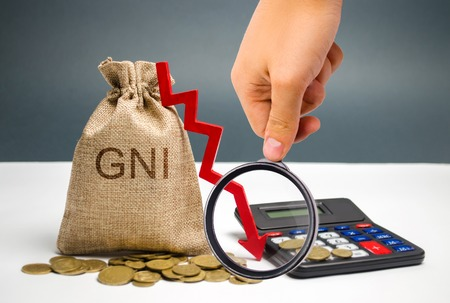 Money bag with the word GNI and the arrow down. The financial and economic crisis in the country. Stagnation. Reform of the economy. Capital outflow. Analysis of the economic situation in the country