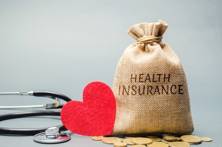 Money bag with coins and the inscription Health Insurance and a heart with a stethoscope. The concept of medical insurance of life, family, health. Healthcare. The accumulation of money. Saving