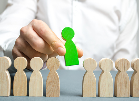 The leader chooses the person in the the team. Talented worker. Hiring staff. Employee search. Promote. Human Resource Management. Choosing a new leader in the team. Dismissal. Successful choice. Stock Photo