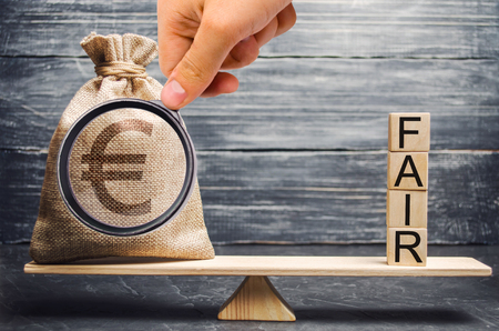 Euro money bag and wooden blocks with the word Fair. Balance. Fair value pricing, money debt. Investment analysis. Fair deal. Reasonable price. Justified risk. Honest loan. Secured loans. Stock fotó