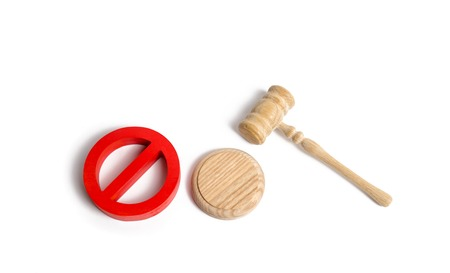 Judge's gavel and red symbol NO. Laws and regulations aimed at prohibition and restriction. Censorship. Termination of the criminal case, the abolition of scandalous laws. Not enough evidence.
