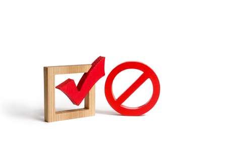 A red check mark and a NO symbol. lack of choice or election of the state. Restriction of rights and freedoms. No option, unavailability. Laws on prohibition and infringement. Repeal of law Stock Photo