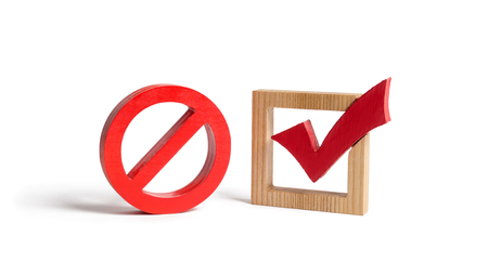 A red check mark and a NO symbol on an isolated background. lack of choice or election of the state. Restriction of rights and freedoms. No option, unavailability. Laws on prohibition and infringement