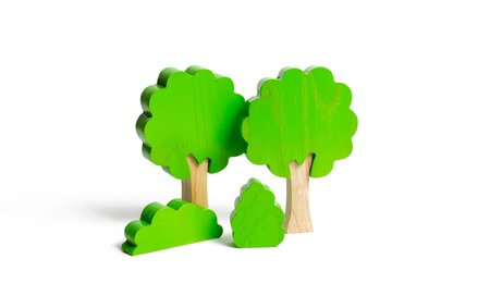 Wooden figures of trees and bushes on an isolated background. The concept of forests and nature. Preserving the environment from human influence. Illegal deforestation. Restoration of natural habitats 写真素材
